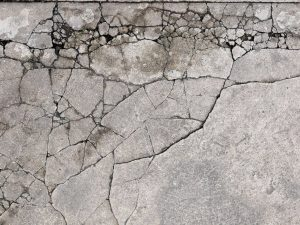 how to fix cracks in patio concrete